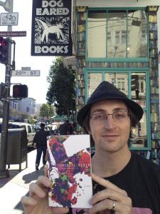 Author Nathaniel Kressen with his hand-bound novel, Concrete Fever.